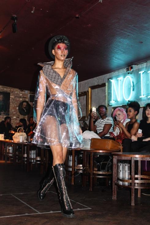 Model Antoinette in transparent raincoat . Courtesy of Jocelyn Rigby